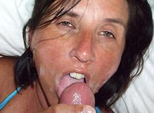 tanned wife milks a big cock all over her face